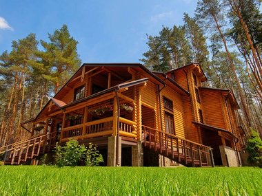 Big wooden mansion in pine forest