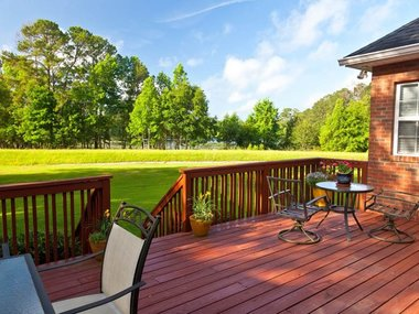 20933342 - residential backyard deck overlooking lawn and lake